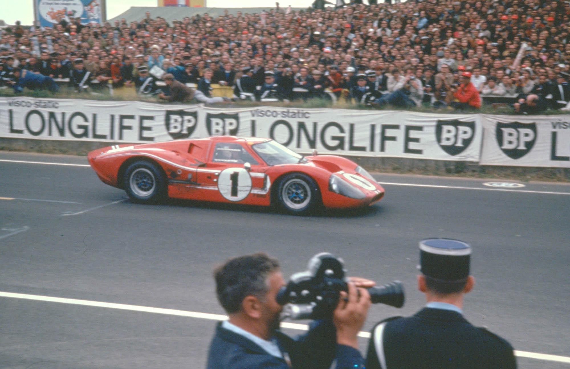 24 Hours of LeMans LeMans France 1967. AJ Foyt/Dan Gurney Ford Mark IV takes the flag. CD#0554-3252-2891-2.