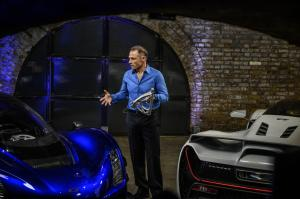 9. CEO and Founder Kevin Czinger at worldwide reveal in London, UK holding a front upper control arm